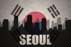 Abstract silhouette of the city with text at Seoul the vintage south korea flag. Background royalty free stock image