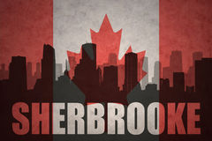 Abstract silhouette of the city with text Sherbrooke at the vintage canadian flag Royalty Free Stock Image