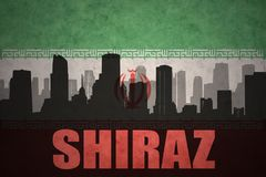 Abstract silhouette of the city with text Shiraz at the vintage iranian flag. Background Royalty Free Stock Photography