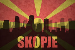 Abstract silhouette of the city with text Skopje at the vintage macedonian flag Royalty Free Stock Images
