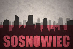 Abstract silhouette of the city with text Sosnowiec at the vintage polish flag. Background Royalty Free Stock Photo