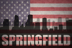 Abstract silhouette of the city with text Springfield at the vintage american flag. Background stock photo