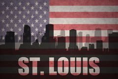 Abstract silhouette of the city with text St. Louis at the vintage american flag. Background Royalty Free Stock Photos
