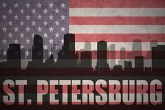 Abstract silhouette of the city with text St. Petersburg at the vintage american flag Royalty Free Stock Photo