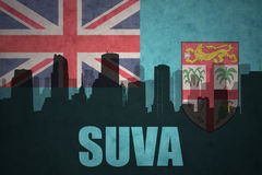 Abstract silhouette of the city with text Suva at the vintage Fiji flag Stock Photos