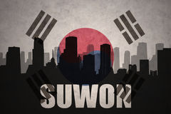 Abstract silhouette of the city with text Suwon at the vintage south korea flag. Background royalty free stock photos