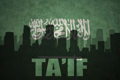 Abstract silhouette of the city with text Ta`if at the vintage saudi arabia flag. Background Royalty Free Stock Photography
