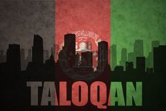 Abstract silhouette of the city with text Taloqan at the vintage afghanistan flag. Background Stock Photo