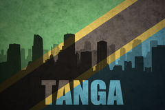 Abstract silhouette of the city with text Tanga at the vintage tanzanian flag Stock Photo