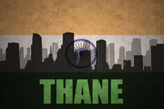 Abstract silhouette of the city with text Thane at the vintage indian flag. Background Royalty Free Stock Image