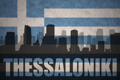 Abstract silhouette of the city with text Thessaloniki at the vintage greece flag Royalty Free Stock Photos