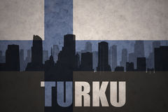 Abstract silhouette of the city with text Turku at the vintage finnish flag Stock Images