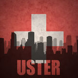Abstract silhouette of the city with text Uster at the vintage swiss flag. Background royalty free stock photography
