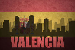 Abstract silhouette of the city with text Valencia at the vintage spanish flag. Background Stock Images