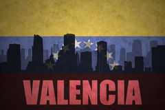 Abstract silhouette of the city with text Valencia at the vintage venezuelan flag. Background Stock Photography