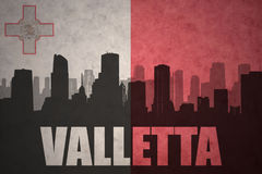 Abstract silhouette of the city with text valletta at the vintage maltese flag Stock Image