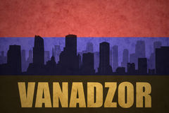 Abstract silhouette of the city with text Vanadzor at the vintage armenian flag Stock Photo