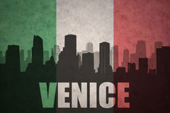 Abstract silhouette of the city with text Venice at the vintage italian flag Stock Image