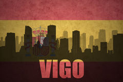 Abstract silhouette of the city with text Vigo at the vintage spanish flag Royalty Free Stock Photo