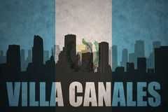 Abstract silhouette of the city with text Villa Canales at the vintage guatemalan flag Stock Images