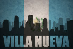 Abstract silhouette of the city with text Villa Nueva at the vintage guatemalan flag Royalty Free Stock Photo