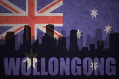 Abstract silhouette of the city with text Wollongong at the vintage australian flag Stock Photography