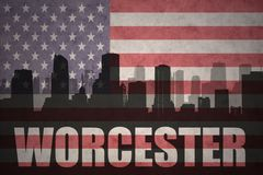 Abstract silhouette of the city with text Worcester at the vintage american flag. Background royalty free illustration