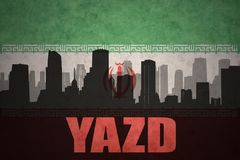 Abstract silhouette of the city with text Yazd at the vintage iranian flag. Background Stock Photography