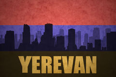 Abstract silhouette of the city with text Yerevan at the vintage armenian flag Royalty Free Stock Image