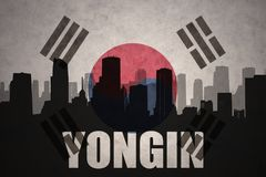 Abstract silhouette of the city with text Yongin at the vintage south korea flag. Background stock photos