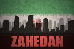 Abstract silhouette of the city with text Zahedan at the vintage iranian flag. Background Stock Photography
