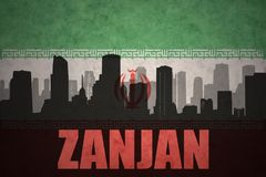 Abstract silhouette of the city with text Zanjan at the vintage iranian flag. Background Royalty Free Stock Images