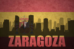 Abstract silhouette of the city with text Zaragoza at the vintage spanish flag. Background Stock Photos