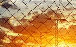 Abstract, silhouette colorful of net around field soccer in the sunset background Stock Image