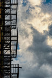 Abstract Fire escape silhouette and cloudy skies Royalty Free Stock Images