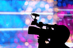 Abstract with silhouette of Photographer video on stage and blur Royalty Free Stock Photos