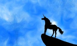 Abstract silhouette unicorn on black cliff. Abstract silhouette unicorn on the top of black cliff in light forest under blue mysterious sky illustration design stock illustration