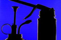 Abstract Silhouetted  Oil Cans Stock Image