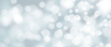 Abstract silver bokeh background. With snowfall at wintertime royalty free stock photography