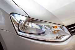 Abstract Silver Car And Front Headlight Stock Image