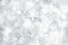 Abstract silver Christmas background with white snowflakes. Light silver abstract Christmas background with white snowflakes Stock Photos