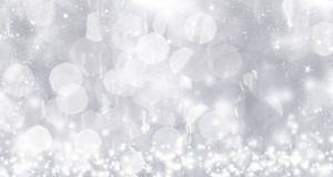 Abstract silver Christmas background with white snowflakes Royalty Free Stock Photo