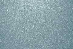 Abstract silver glitter texture background. Glittering silver grain or shining particles with sparkling light effect background fo. R Christmas modern trendy stock image