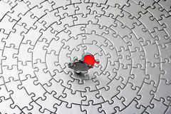 Abstract of a silver jigsaw with the last piece upstanding Royalty Free Stock Image