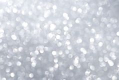 Abstract silver light bokeh background. Festive concept background Stock Photo