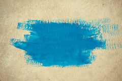 Abstract simple background brushstrokes of blue paint on a beige background Royalty Free Stock Images