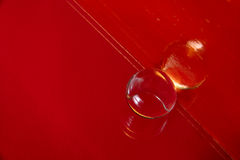 Abstract single transparent ball on red background Stock Photo