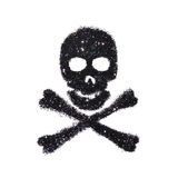 Abstract skull and crossbones of black glitter on white background - interesting element for your design Stock Photo