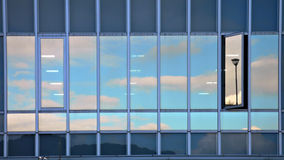Abstract sky reflection. Cloudy sky reflection in modern building glass wall Royalty Free Stock Photography