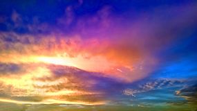 Abstract of sky at sunset. Blue and orange abstract of clouds in sky at sunset Royalty Free Stock Image